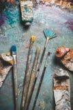 Paintbrushes and Paint Tubes. Art brushes paintbrushes tools close-up painting paint tube stock photography