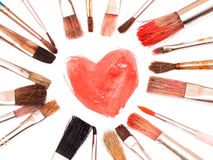Paintbrushes and painted heart Stock Photography