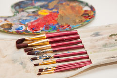 Paintbrushes and painter's palette. Paintbrushes and a painter's palette on a white background Stock Photos