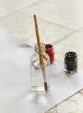 Paintbrushes paints Stock Photography