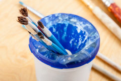 Paintbrushes on palette. Stock Photos