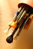 Paintbrushes and pens Stock Image