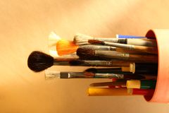 Paintbrushes and pens Stock Photo
