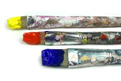 Paintbrushes and primary colors. On white background stock images