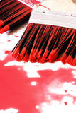 Paintbrushes and the red colour Stock Images