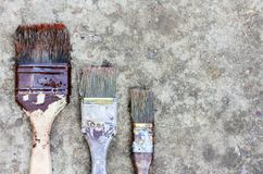 Paintbrushes on the sidewalk, well used with copy space for text royalty free stock images