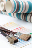 Paintbrushes, wallpapers, and color swatch Royalty Free Stock Photography