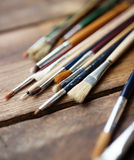 Paintbrushes on a wood Royalty Free Stock Images