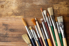 Paintbrushes on wood Stock Photos