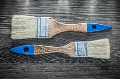 Paintbrushes on wooden board directly above Stock Images