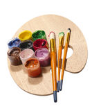 Paintbrushes on wooden palette. royalty free stock photos