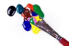 Paintdrops of different colours and paintbrush Stock Images