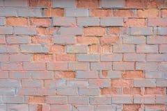 Painted困厄了难看的东西brickwall背景 免版税库存图片