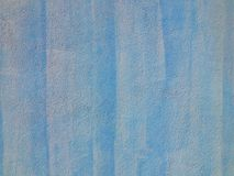 Painted abstract blue background wall texture. Close up of rough textured wall detail painted blue fullframe background Royalty Free Stock Image