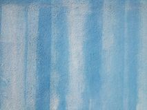 Painted abstract blue background wall texture. Close up of rough textured wall detail painted blue fullframe background Stock Photos