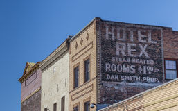 Painted add at the wall of a hotel in Truckee. California, USA royalty free stock images