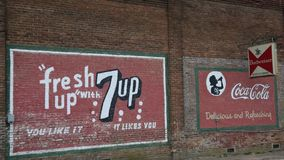 Ads for 7-up, Coca-Cola, and BUdweiser royalty free stock images