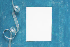 Painted aged blue background with blank sheet of paper Stock Photos