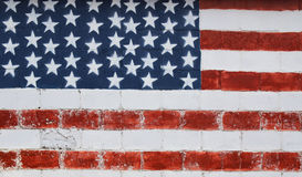 Painted American flag. An American flag on a brick wall Stock Images