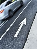 Painted arrow on the street pointing up Royalty Free Stock Photography