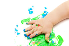 Painted baby hand stock photo