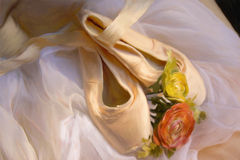 Painted ballet pointe shoes. Ballet pointe shoes with a white drape and flowers.  Created in Corel Painter Royalty Free Stock Photo