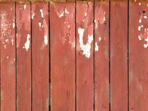 Painted Barn Wood. Wide angle photo of worn barn wood planks with flaking red and white paint stock photos
