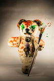 Painted bear toy walking with paintbrush Royalty Free Stock Images