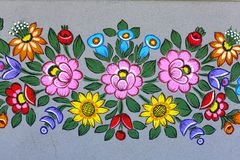 Painted beautiful floral pattern on the facade of an old house, Zalipie, Poland. Painted beautiful floral pattern on the facade of an old house, folk art stock images