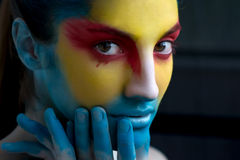 Painted beautiful woman face, artistic make up, body and face ar Stock Images