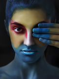 Painted beautiful woman face, artistic make up, body and face ar Stock Photo