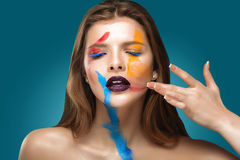 Painted beautiful woman face, artistic make up, body and face art, close up. Facial expression, emotions. Royalty Free Stock Photo