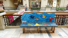 Painted bench. In different colors, Finding Nemo cartoon thematic handmade. GUM -Department store, Moscow, Russia royalty free stock image