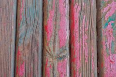 Painted bench surface. Old wooden red bench close-up. the view from the top royalty free stock photography