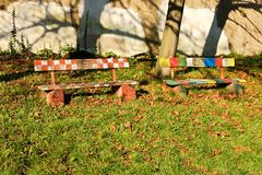 Painted bench. Two painted wooden benches in the park stock photo