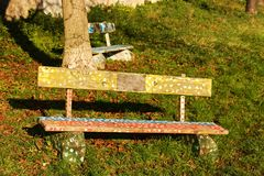 Painted bench. Wooden bench in the park, human hands painted on a wooden bench stock photography
