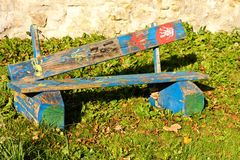 Painted bench. Wooden bench in the park, human hands painted on a wooden bench, destroyed bench royalty free stock photos