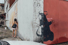 Painted Big Black Rat Between White and Red Wall from The Street of George Town. Penang, Malaysia.  Stock Image