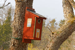 Painted bird house fron side view Stock Photos