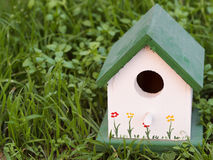 Painted Birdhouse in the Grass Royalty Free Stock Photography