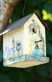 Painted birdhouse in tree Stock Photos