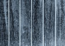 Painted black color on wooden texture with old panels outdoor. Stock Photo