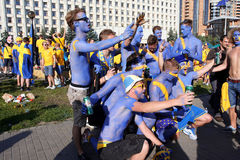 Painted in blue color football fans have fun Stock Image