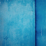 Painted with blue color metal textured background Stock Photos