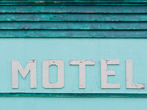 Painted blue-green historic motel facade siding Royalty Free Stock Photo