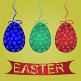 Painted blue, green, red Easter eggs on the ropes with bows. Royalty Free Stock Photography