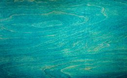 Painted plywood texture. Painted blue plywood texture background royalty free stock image