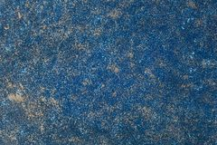 Painted blue vintage wall with golden spots. Wall background. Dark blue backdrop stock images