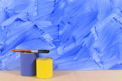 Painted blue wall with paint tins Stock Photo