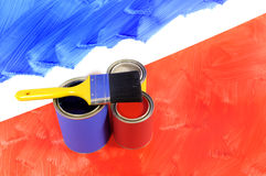 Home decorating - painted blue wall with red floor, paint cans and paintbrush Stock Image